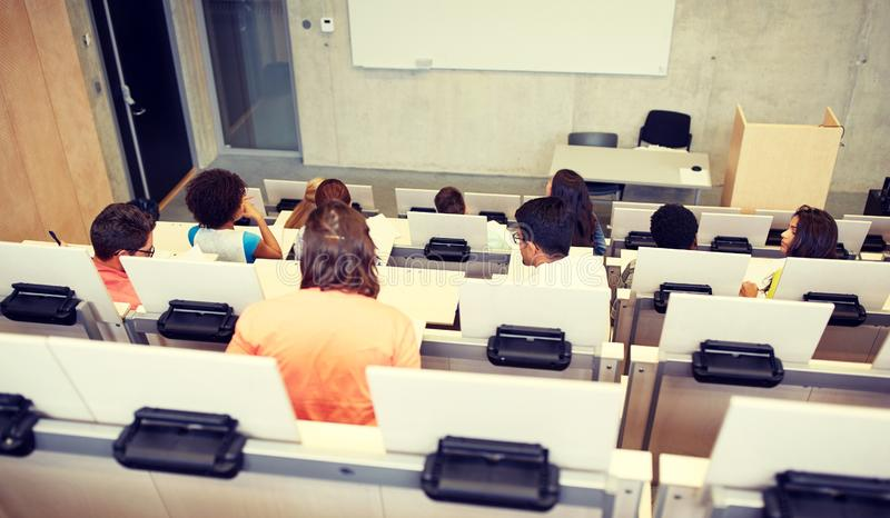 International students at university lecture hall. Education, high school, university, learning and people concept - group of international students in lecture royalty free stock images