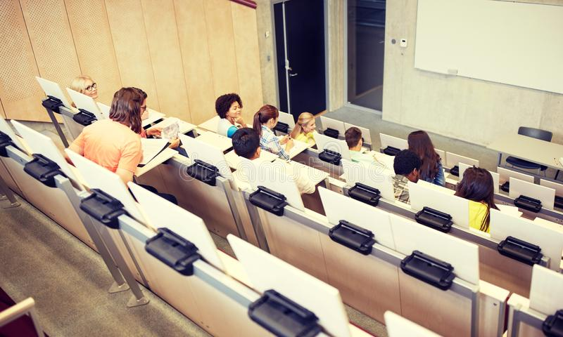 International students at university lecture hall. Education, high school, university, learning and people concept - group of international students in lecture royalty free stock image