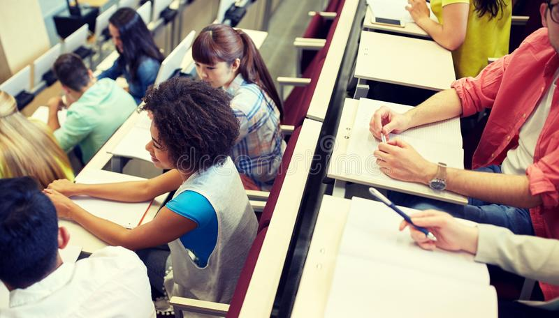 International students at university lecture hall. Education, high school, university, learning and people concept - group of international students in lecture stock photos