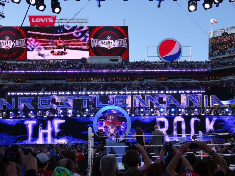 International superstar the Rock, Dwayne Johnson, makes a surprise entrance the arena stock photo