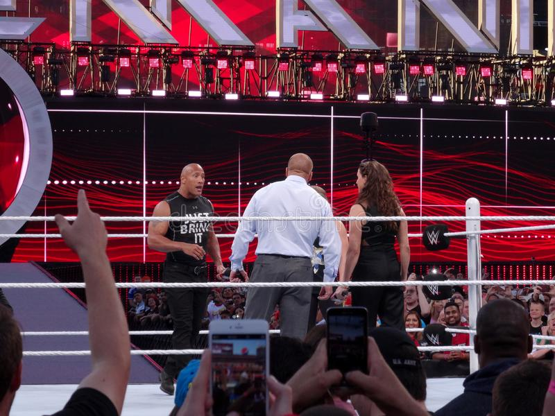 International superstar the Rock, Dwayne Johnson, stands in the ring holding mic royalty free stock photo