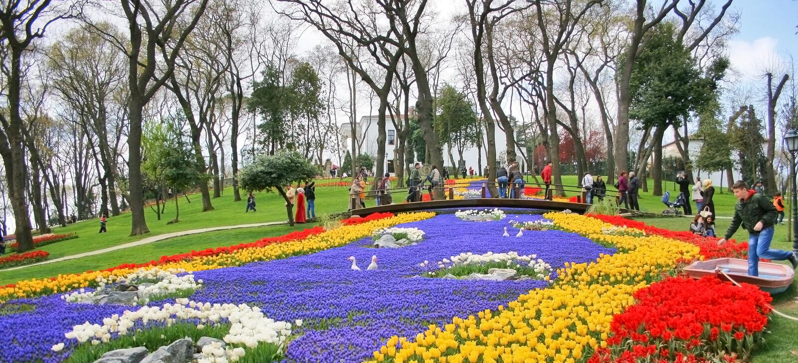 International Tulip Feast ,Istanbul,Turkey. People view tulips and other flowers at 5th International Tulip Festival in Emirgan Wood,Istanbul,Turkey stock photos