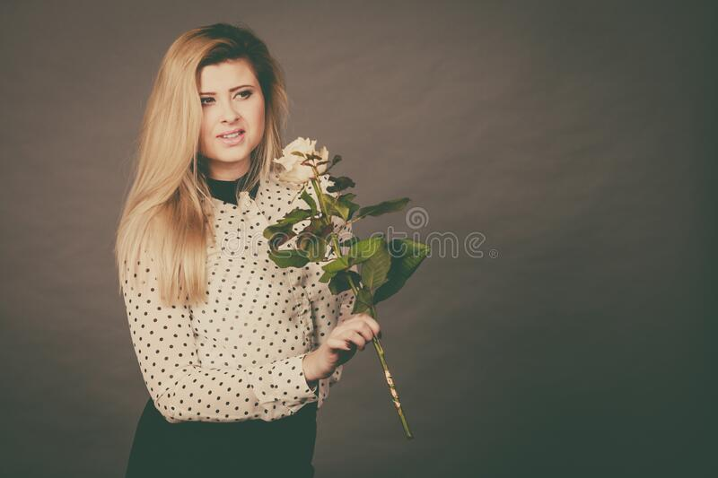 Pretty woman with white rose flower stock image
