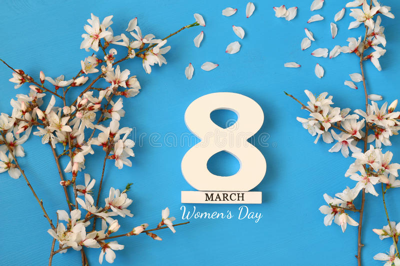 International women day concept. Cherry tree and date royalty free stock photo