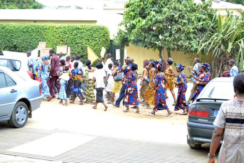 INTERNATIONAL WOMEN'S DAY. African women in uniform parading during the Women's Day with slogan signs to enforce the right to equality stock image