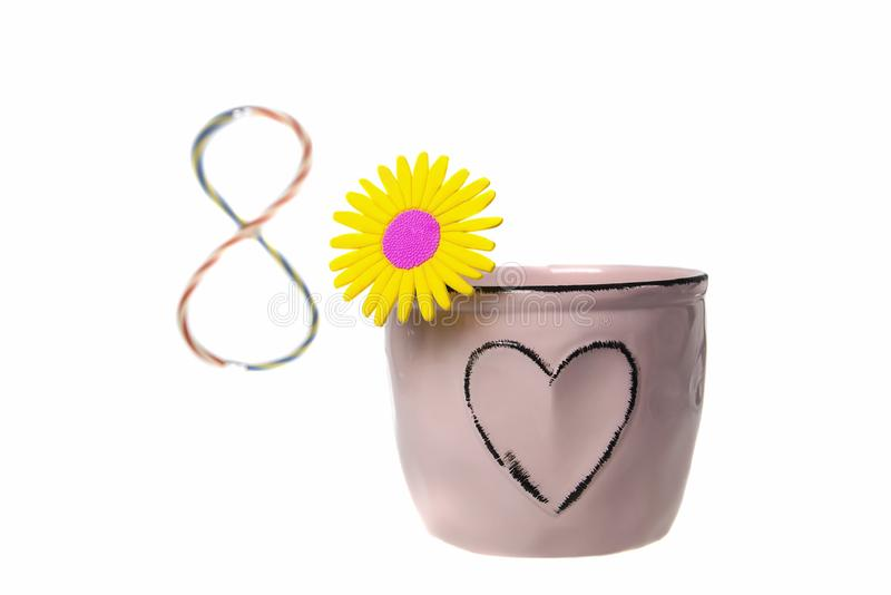 International Women`s Day Greeting Card on March 8th as a flower in a pot with a heart. On a white isolated background stock photography