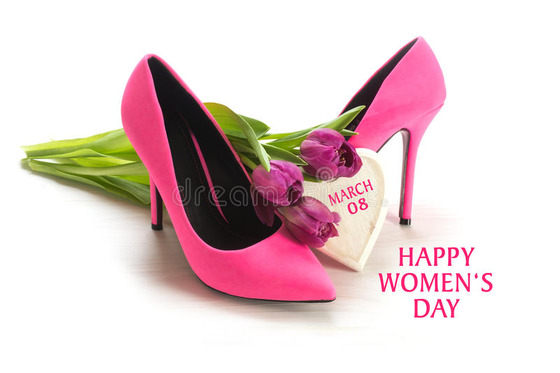 International Women's Day 8 March, ladies pink high heel shoes,. International Women's Day 8 March, greeting card with ladies pink high heel shoes, tulips and a stock photo