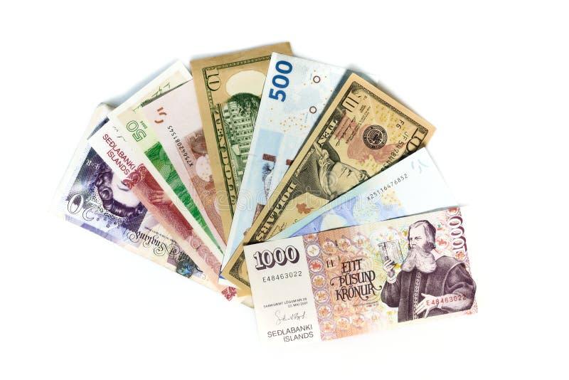 Internationell valuta som fan eller handen av kort royaltyfri bild