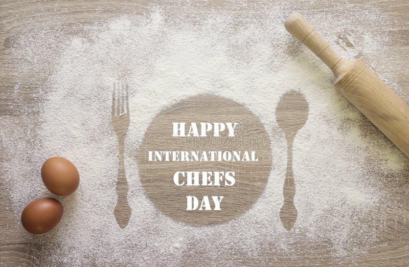 Internationellt kort för kockdaghälsning Tryck av maträtten, gaffeln och s royaltyfri bild