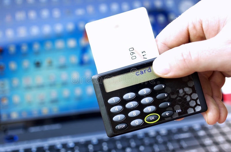 Internet Banking. On-line internet banking security device with card and notebook stock image