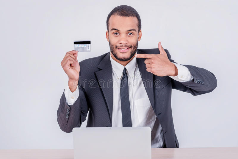 Internet banking. Successful African businessman sitting at a la stock images