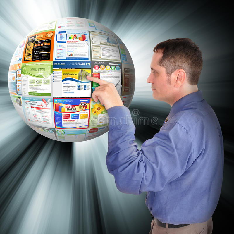 Internet Business Man Pointing to the Web. A business man is pointing to an abstract internet ball with websites on it. There are glowing rays coming out of it