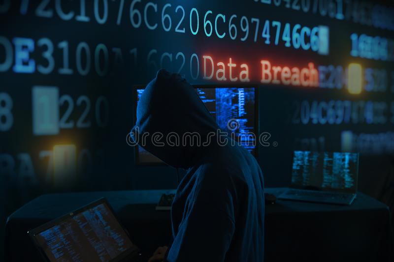 Internet crime concept - hacker. Payments System Hacking. Online Credit Cards Payment Security Concept. Hacker in Black Gloves Hacking the System royalty free stock image