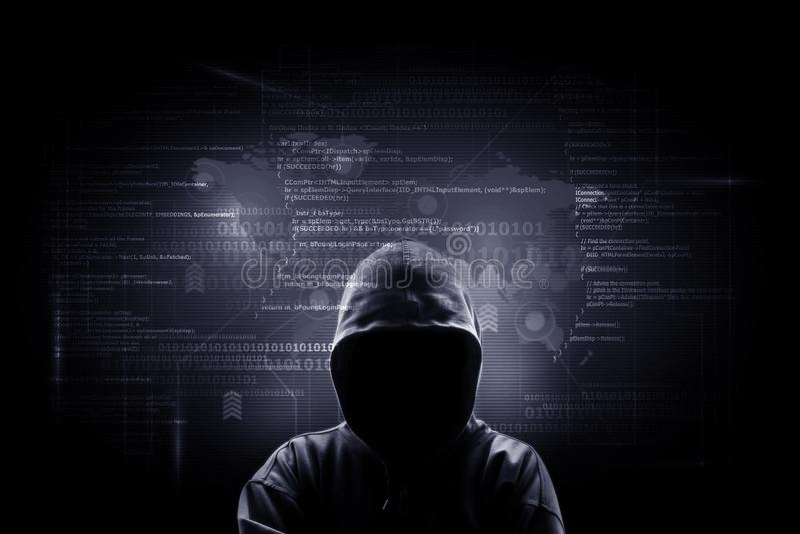 Internet crime concept. Hacker working on a code on dark digital stock photo