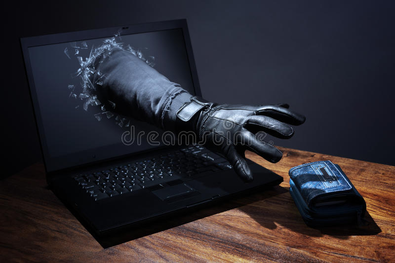 Internet crime and electronic banking security. Stealing a purse through a laptop concept for computer hacker, network security and electronic banking security