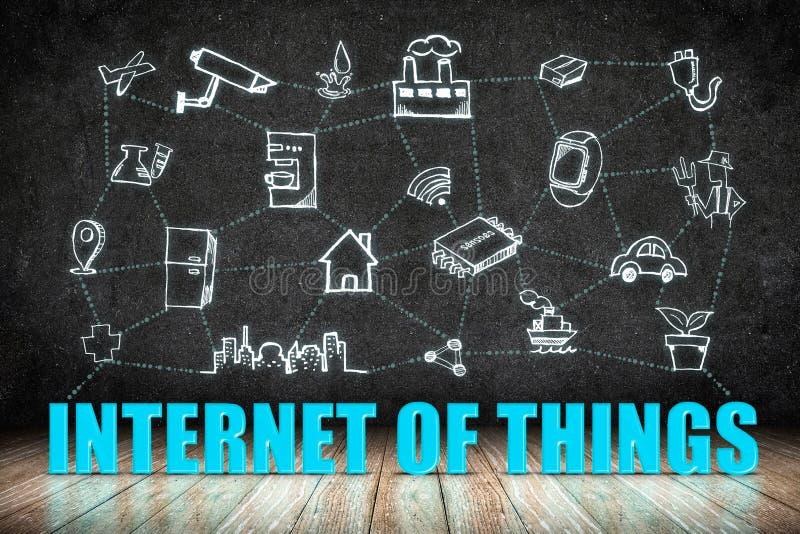 Internet de la palabra de las cosas (IoT) en el piso de madera con el icono del garabato encendido libre illustration