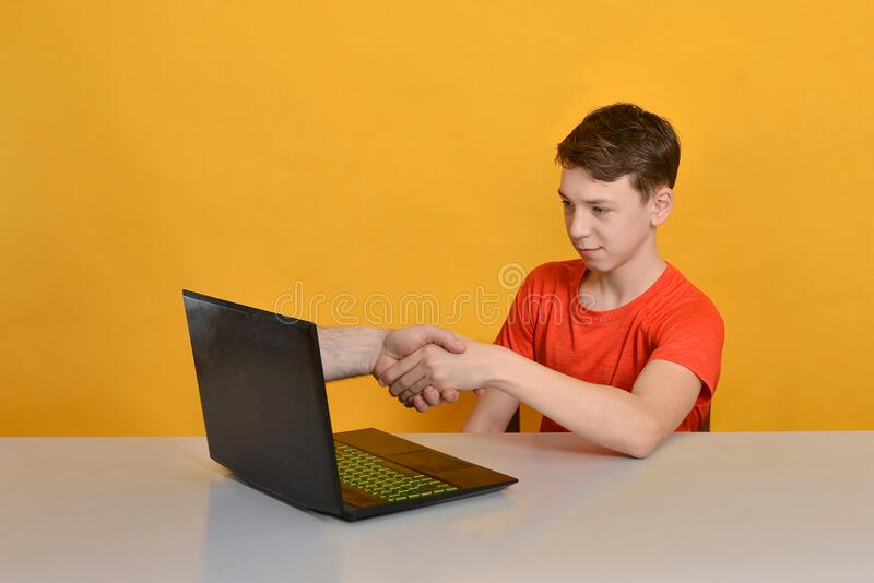 Internet friends over laptop monitor. The concept of virtual friendship and online communication.  royalty free stock image