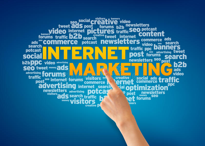 Internet Marketing. Hand pointing at an Internet Marketing word cloud on blue background royalty free stock photo