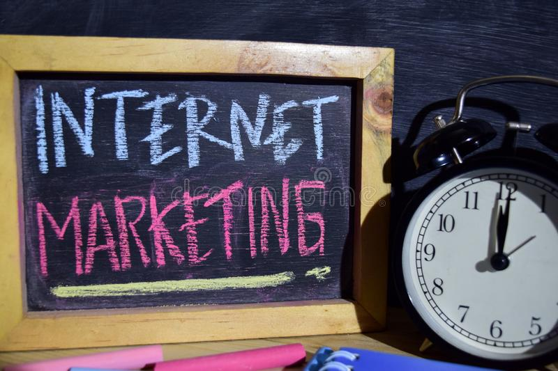 Internet marketing on phrase colorful handwritten on blackboard. stock photos