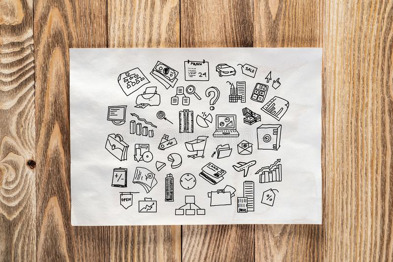 Internet marketing service hand drawn. With group of business doodles. Banking, shopping and traveling symbols on white page. Top view of workplace with paper royalty free stock photography
