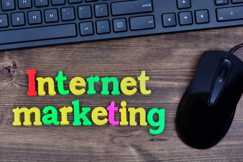 Internet marketing words on table. Internet marketing words on wooden table stock photo