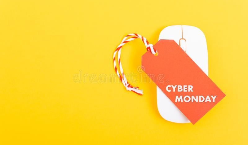 Internet online shopping marketing, Promotion Cyber Monday text on red tag label and white mouse royalty free stock photo
