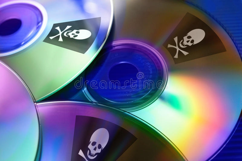 Internet piracy - illegal trademark abuse - criminality - DVD co royalty free stock images