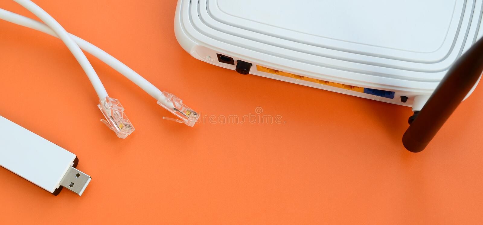 Internet router, portable USB wi-fi adapter and internet cable p royalty free stock images