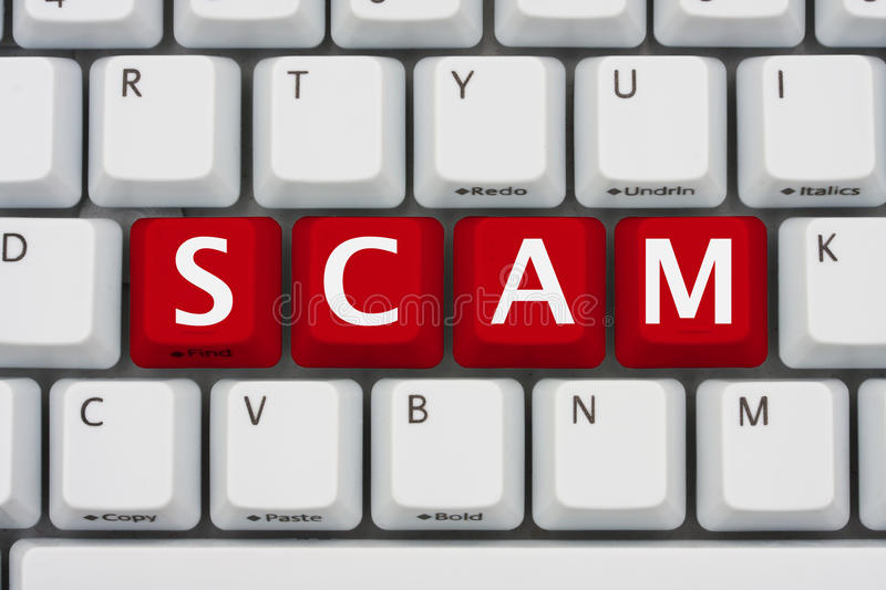 Internet Scams. A computer keyboard with red keys spelling scam, Internet Scams
