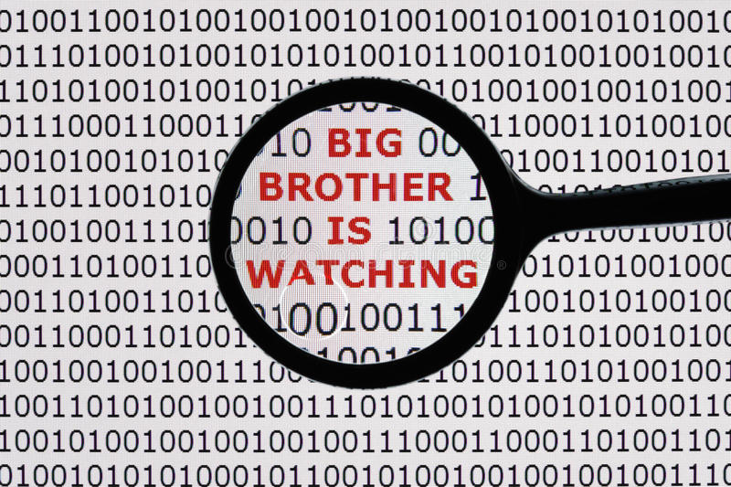 Big brother is watching. Internet security concept the words big brother is watching on a digital tablet screen with a magnifying glass royalty free stock photography