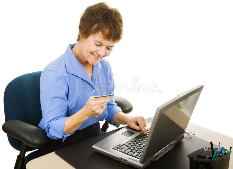 Internet Shopping. Mature office worker takes a few minutes to shop on the internet. Isolated on white royalty free stock photo