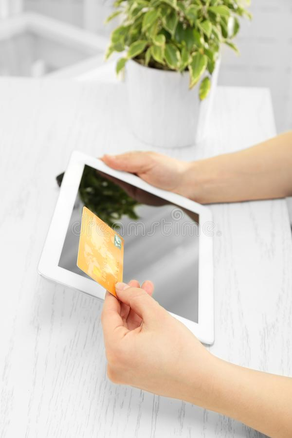 Internet shopping concept. Woman paying online order with card royalty free stock photo