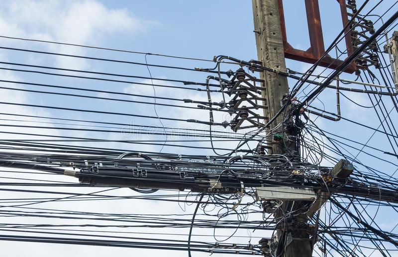 Internet signal box. Power lines and Internet signal box on cement pillars in rural Thailand royalty free stock photos