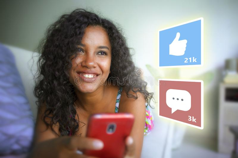 Internet social media app likes and chat comments icons composite on young beautiful and happy mixed ethnicity black African royalty free stock image