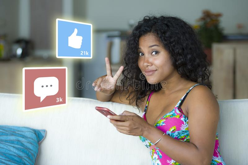 Internet social media app likes and chat comments icons composite on young beautiful and happy mixed ethnicity black African stock images