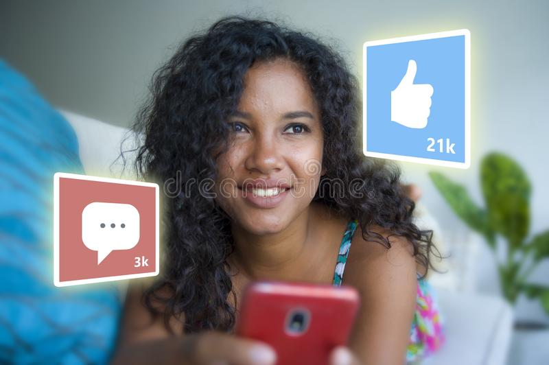 Internet social media app likes and chat comments icons composite on young beautiful and happy mixed ethnicity hispanic woman at royalty free stock photo