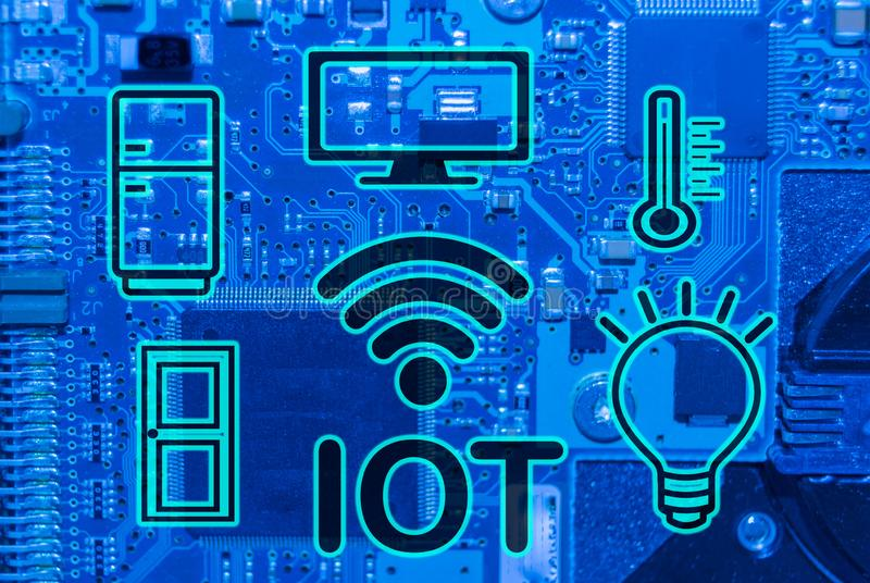 INTERNET OF THINGS CONCEPTS ON ELECTRONIC BOARD BACKGROUND royalty free stock image