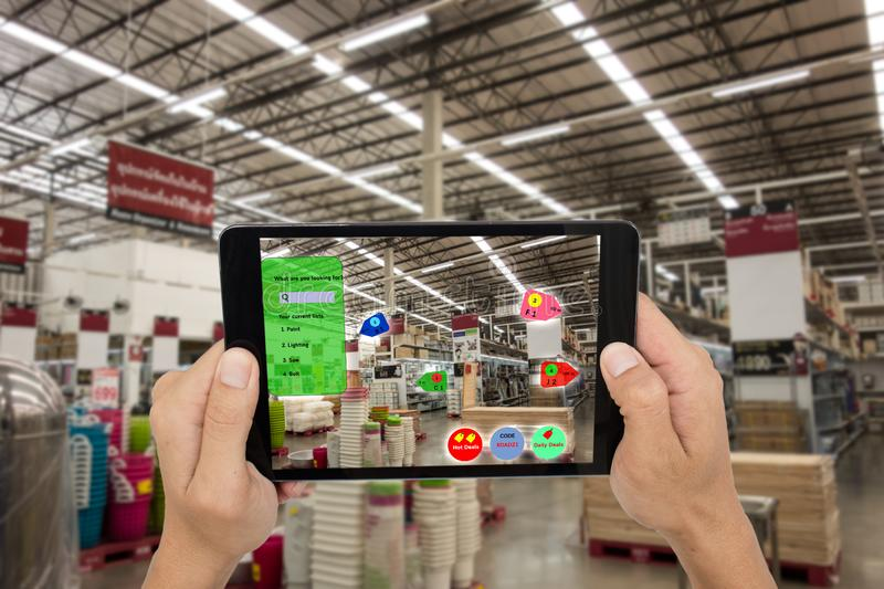 Internet of things marketing concepts,smart augmented reality,customer hold the taplet to see the product that search by ai applic stock photos
