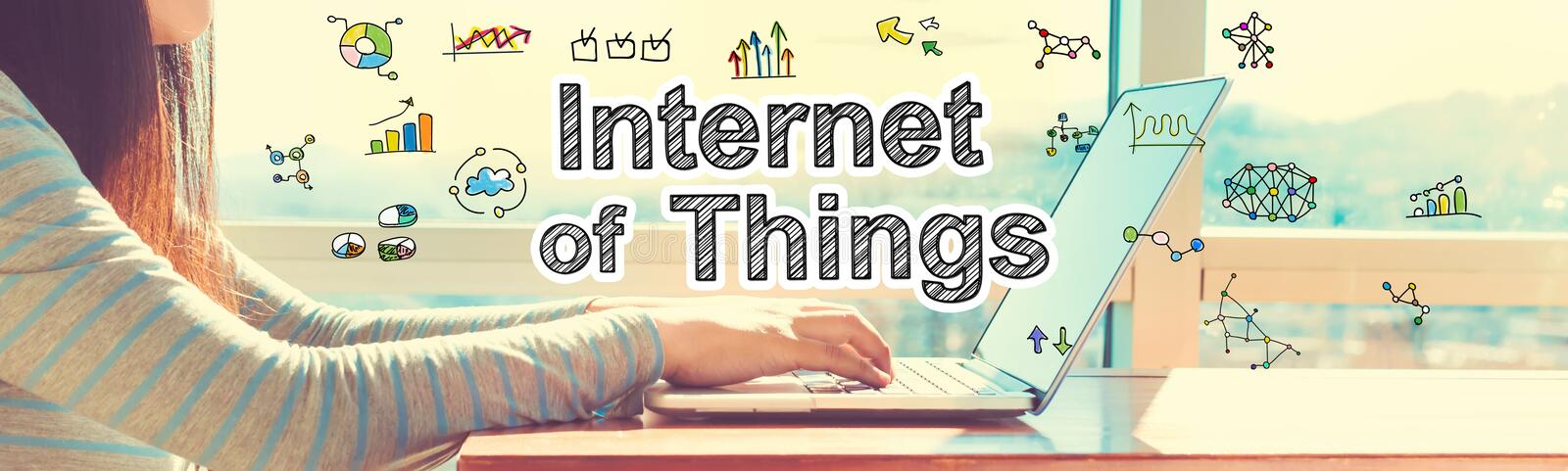 Internet of Things with woman working on a laptop. In brightly lit room stock images