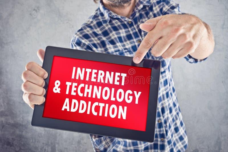 Internet und Technologie-Sucht lizenzfreies stockbild