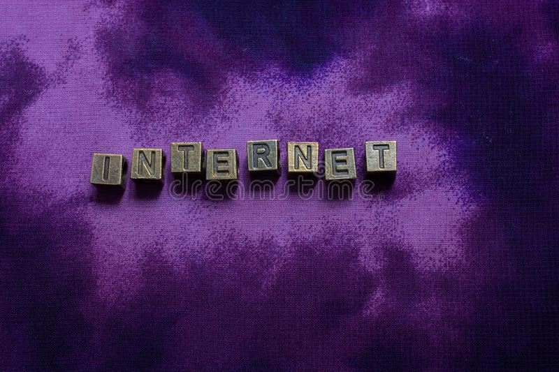 Internet wording with metal letters as net and business concept. Internet wording with letters as net and business concept stock images