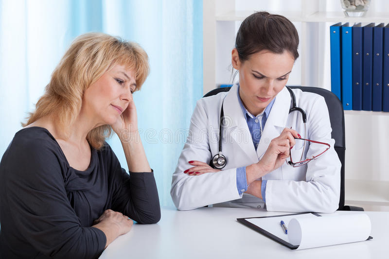Internist having bad news for a patient stock photo