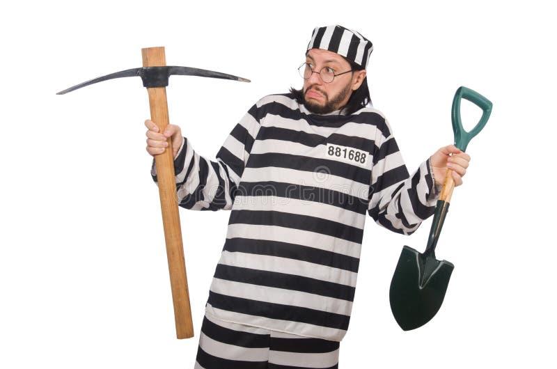 Interno da prisão com machado e pá imagem de stock