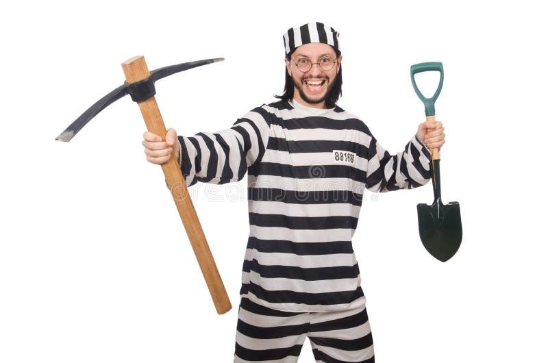 Interno da prisão com machado e pá imagem de stock royalty free