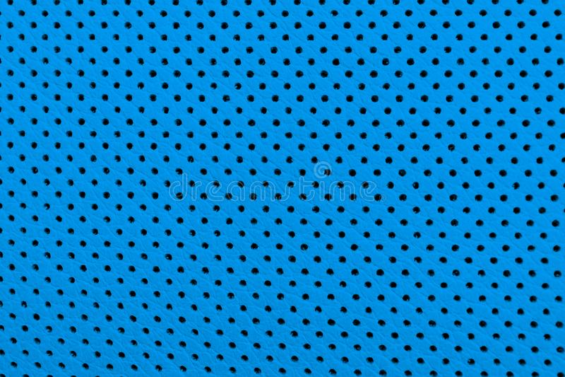 Interno di cuoio blu dell'automobile di lusso moderna Parte dei dettagli di cuoio perforati della sede di automobile Fondo di cuo immagine stock libera da diritti
