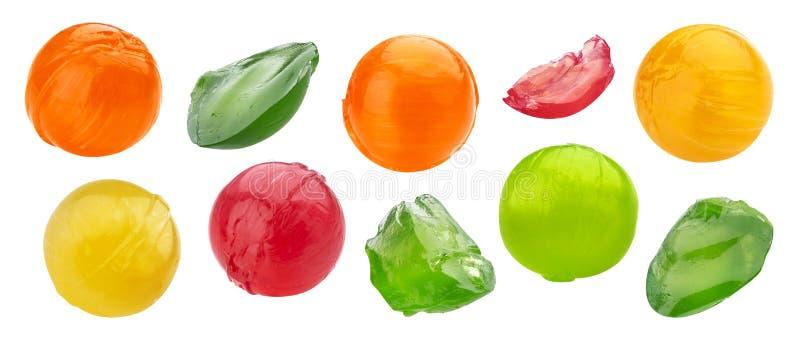 Intero e dei pezzi insieme pungente della lecca-lecca dolce multicolore fotografia stock libera da diritti