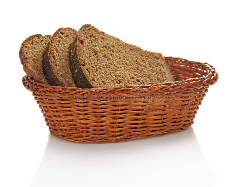 Intero pane fresco del grano che cuting sulle fette fotografia stock