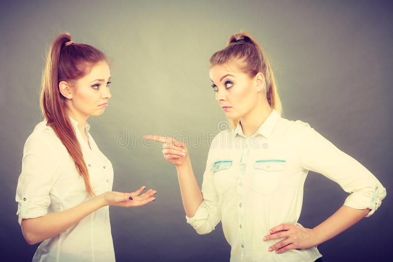 Two girls having argument, interpersonal conflict. Interpersonal conflict, bad relationships, friendship difficulties concept. Quarrel between two young women stock images