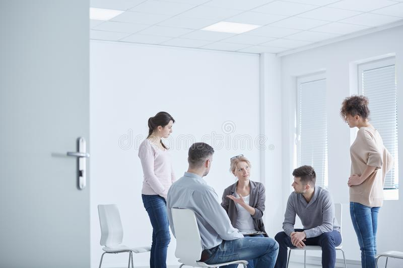 Interpersonal therapy with friends. Two women on a interpersonal therapy with their friends and psychologist stock photo
