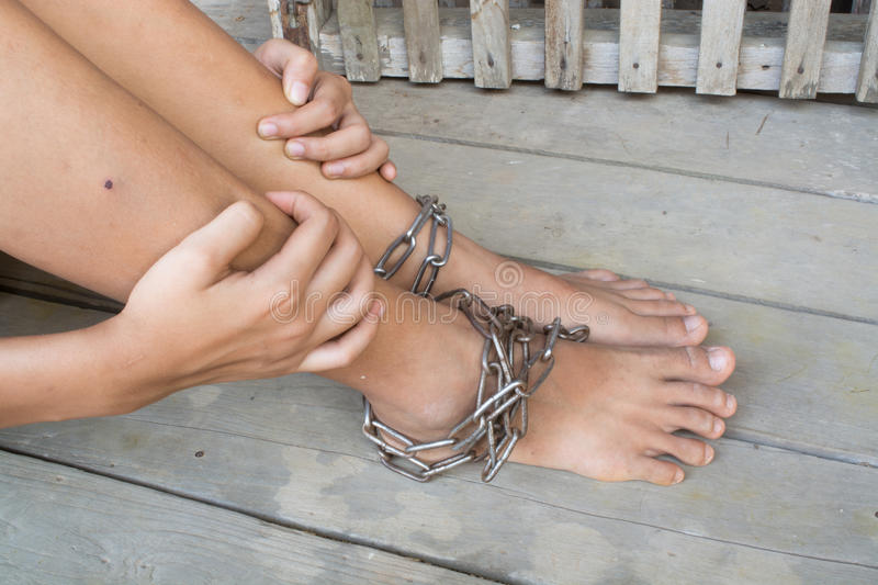 Interpreter. Child was gets foot interpreter by the chains royalty free stock image